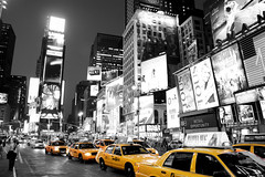 Times Square New York Black White and Yellow taxi cab! 72,000 views! (Paul in Leeds) Tags: street camera new york city white black slr cars yellow night digital square lights traffic quality taxi sony times alpha dslr cabs a350 lensers platinumbestshot