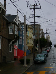 A Splash of Color (lefeber) Tags: sanfrancisco california road street city houses windows urban architecture facade buildings vanishingpoint downtown cloudy balcony hill victorian angles sidewalk powerlines rainy telephonepoles telephonewires baywindows queenannestyle