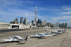 Toronto City Centre Airport (Tom Podolec) Tags: city sky 6 lake toronto ontario canada building wall skyline canon lens island is airport downtown view calendar angle air centre wide aerial line turbo cameron service mm usm piper dslr 1785 1979 efs cessna 30d f456 allrightsreserved stationair cytz ytz pa31t news46 tu206g 200710261153120076 n80cp cggsg cfoib thisimagemaynotbeusedinanywaywithoutpriorpermission 20062008 canonefs1785mmf456isusmwideanglelens wallpx