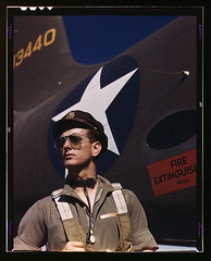 F.W. Hunter, Army test pilot, Douglas Aircraft Company plant at Long Beach, Calif.  (LOC) (The Library of Congress) Tags: portrait man hat sunglasses fashion airplane army star glasses october uniform unitedstates wwii jet style scene slidefilm worldwarii longbeach 1940s american transparency ww2 intrepid americana 4x5 lf libraryofcongress 1942 airforce usaf aviator pilot largeformat longbeachca worldwar2 stylish usairforce a20 wartime chap transparencies havoc calfornia dashing aviatorglasses unitedstatesairforce usarmyaircorps vintageaircraft testpilot historicalphotographs mikehunter douglasaircraft xmlns:dc=httppurlorgdcelements11 douglasaircraftcompany october1942 dc:identifier=httphdllocgovlocpnpfsac1a35333 alfredtpalmer fireexstinguisherinside alfredpalmer fwhunter