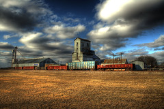 small rail stop (aero nerd) Tags: storm west abandoned oklahoma field grass car architecture clouds train canon lens nikon rust box south elevator best explore american boxcar kit 18 55 morrison hdr decayed nothern flatbed grainsilo praire explored xti creativelightningawards