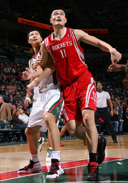 Yao Ming and Yi Jianlian battle for position Saturday night in a much anticipated match-up.  The game didn't turn out as expected, with Yao and Yi both struggling from the field.