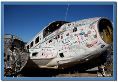 Desert Bird (CameraOne) Tags: abandoned digital airplane grafitti desert aircraft nevada stickers canon5d parked decals wrecked ruined grounded highway95 canon1740mm wreckedplane thatsbostin twinengineaircraft