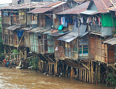 Riverside (color): slums by the Ciliwung river (Tempo Dulu) Tags: poverty travel urban river indonesia nikon asia d70 jakarta slums thirdworld ciliwung bukitduri
