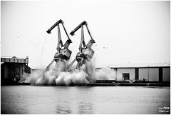 Demolition of cranes at Birkenhead Docks (petecarr) Tags: morning rain docks reflections explosion overcast demolition cranes bang wirral