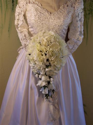 White silk rose cascade bridal bouquet.