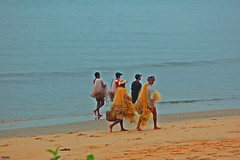 Morning march (manojsai) Tags: street sea fish nature water girl grass fisherman sand bathing nets calmness