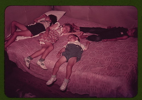 Children asleep on bed during square dance, McIntosh County, Okla. (LOC)
