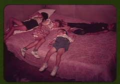 Children asleep on bed during square dance, Mc...