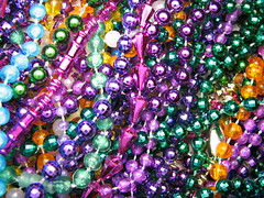 Mardi Gras Beads (jciv) Tags: desktop carnival party wallpaper macro beads louisiana colorful neworleans decoration mardigras celebrate decorate krewe throws file:name=img4734