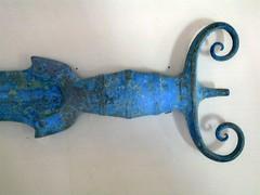 The antenna-hilt of an antenna-hilted sword (diffendale) Tags: blue italy museum bronze italia sword museo perugia antenna umbria spada hilt nazionale archeologico bronzo dellumbria