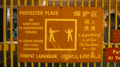 Protected Place (ampontour) Tags: sign warning fence singapore widescreen 169 armed handsintheair noadmittanceto unauthorisedpersons