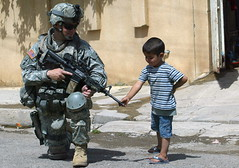 US SOLDIER IN MOSUL, IRAQ (crazymaq) Tags: horizontal children soldier army marine war refugee iraq navy young egypt middleeast baghdad karbala mosul trauma anbar