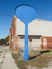 Blue nonsign of OK and Coast to Coast Livin. (Tim Kiser) Tags: 2015 20151025 adrian adrianmichigan coasttocoastlivin img1611 lenaweecounty lenaweecountymichigan michigan ok october october2015 pearlstreet abandonedsign blue bluepaint bluesign building cloudlesssky coasttocoast downtown downtownadrian electriclines emptysign freestandingsign graffiti gravel livin messages nonsign overheadelectriclines overheadpowerlines paved pavement powerlines sidewalk sign signpole signlesssign southmichigan southeastmichigan southeasternmichigan southernmichigan sunny wall weeds weedyarea unitedstates