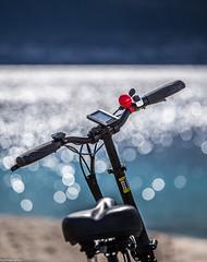 Il Campanellino rosso (gibel49) Tags: sicilia rosso bici bokeh mare stretto messina
