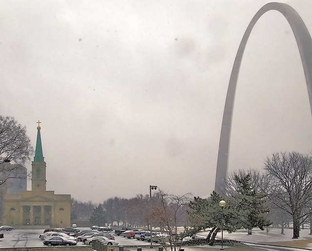 Basilica of Saint Louis, King of France, and Gateway Arch, in Saint Louis, Missouri, USA - during snowfall