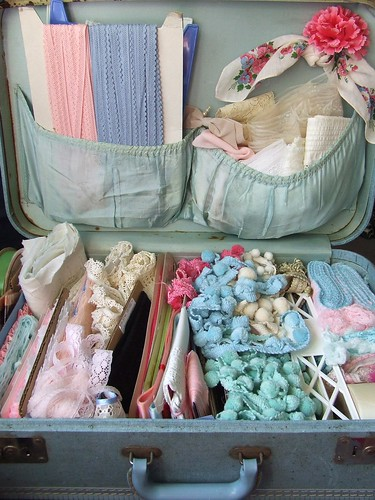 Sewing supplies in vintage suitcase, via Flickr: little pink studio