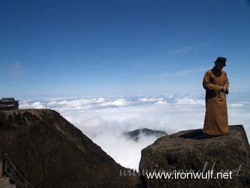 Monk in Prayer Above the Clouds