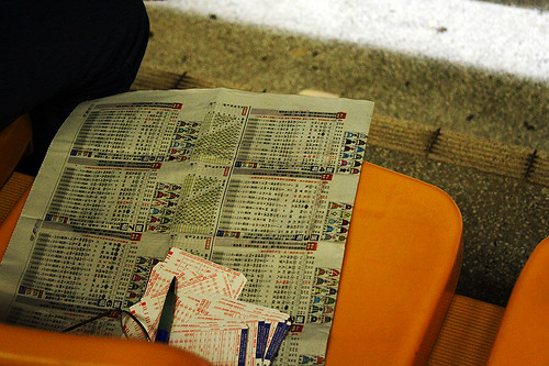 betting slips and newspaper