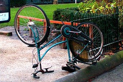 Street Art - Amsterdam (photo_generator) Tags: park street sleeping abstract abandoned cortina netherlands strange amsterdam bike bicycle wheel path spokes transport chain odd unusual inverted quirky saddle locomotion pedal circular campille