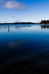 Tofino Blues (Mike Bingley) Tags: ocean blue people canada reflection beach water bc pacific britishcolumbia vancouverisland pacificocean tofino