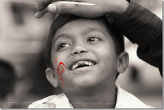 Painted Smile (Shabbir Ferdous) Tags: kids photographer bangladesh facepaints bangladeshi canoneosrebelxti 21stfebruary shabbirferdous 21feb2008 shabbirspeople sigmazoomtelephoto70300mmf456apodgmacro wwwshabbirferdouscom shabbirferdouscom