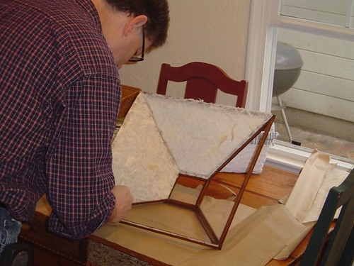 Glueing the paper to the lamp shade frame