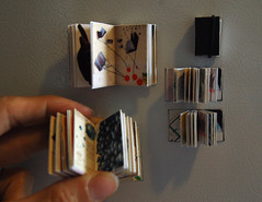 itty bitty books on the fridge (R.bean) Tags: art moleskine miniature mini sketchbook tiny micro bookart bitesize thumbsize iwanttoeatthem