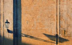 The Shadows Are Getting Longer (Philipp Klinger Photography) Tags: light shadow orange color colour detail texture church glass lamp lines yellow metal wall evening nikon warm europe long pattern republic afternoon czech prague prag praha tschechien minimal line lantern minimalism eastern philipp republika josefov klinger ceska czechy josefstadt esk tschechei d700 sigma50mmf14 vanagram