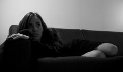 Bellis perennis (Mm) Tags: light portrait italy woman milan canon hair nose eos blackwhite donna spring model eyes italia finger interior milano couch occhi ritratto lombardia biancoenero naso 400d