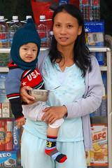 (SLpixeLS) Tags: street boy portrait people woman baby asia femme vietnam hoian asie bateau rue enfant barque earthasia