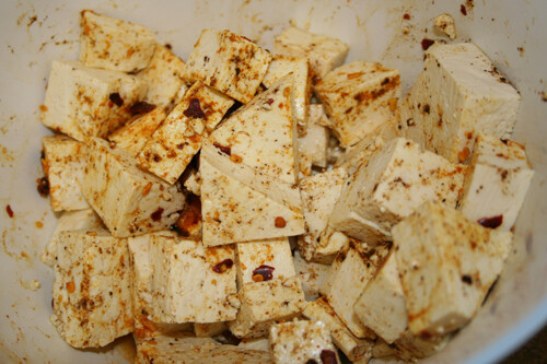 Cut tofu and coat evenly with spice mix