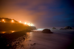 Dashed Upon the Rocks (Ar'alani) Tags: ocean sanfrancisco california street city longexposure travel mist fog lights rocks glow sutrobaths afterdark cliffhouse canon1022mm
