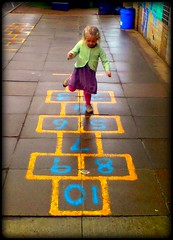Hop Scotch (Lucrezya) Tags: street uk school geometric childhood playground concentration child britain traditions games innocence hopscotch hop brightcolours marelle thebestofday geometricfun concentratinglook pincaro