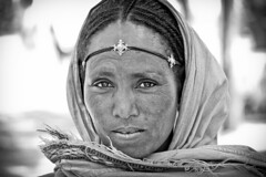 Ethiopian woman, portrait (NeSlaB .) Tags: world portrait blackandwhite woman festival canon easter religious photo blackwhite eyes women dress faith religion folklore holy oldwoman christianity ethiopia rite pilgrim axum rites developingcountries reportage pilgrims hosanna etiopia aksum  thirld stmaryzion hosannafestival neslab