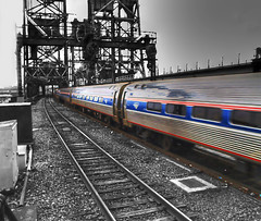 Amtrak Express (Videoal) Tags: railroad bridge blue red white train photoshop blackwhite newjersey tracks nj signals amtrak newark hdr commuters pennstation photomatix flickrsbest diamondclassphotographer flickrdiamond