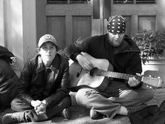 Vagrants - Street Performer & Girlfriend (JRGuinness) Tags: music woman playing man guy female austin outdoors girlfriend couple downtown texas guitar candid homeless streetperformer vagrant streetperson kodakc633