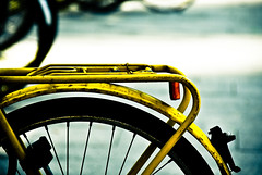 Yellow bike (manganite) Tags: old color topf25 colors station bike bicycle wheel yellow contrast digital germany geotagged interestingness google xpro topf50 nikon topf75 europe tl main central cologne kln used explore d200 nikkor dslr topf100 vignette carrier northrhinewestphalia fav100 interestingness314 i500 18200mmf3556 35faves utatafeature manganite nikonstunninggallery 25faves ipernity challengeyou challengeyouwinner superhearts date:year=2007 geo:lat=50942577 geo:lon=6957771 date:month=april date:day=1 format:ratio=32