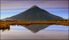 Taranaki reflected in the Pouakai Tarns (katepedley) Tags: new morning newzealand mist mountains fog sunrise reflections volcano nationalpark interestingness cone hiking symmetry panasonic explore zealand alpine nz northisland andesite tarn tramping taranaki egmont fz30 dormant stratovolcano mttaranaki mounttaranaki gndfilter pouakairanges nz101 pouakaitarns nz101mounttaranaki