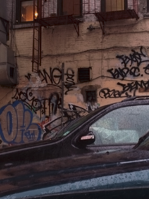 cars and graffiti and rain