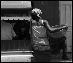 woman and basket (LindsayStark) Tags: travel blackandwhite haiti women war carribean conflict humanrights humanitarian humanitarianaid emergencyrelief waraffected