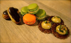 chocolate eclairs, orange and pistachio macarons, & pistachio creme brulée