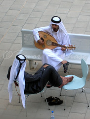 Desert Melodies (WanderWorks) Tags: music men outside costume chair gulf dress guitar sandals middleeast east instrument arabia strings arabian middle oud doha qatar cufflinks cufflink egal stringed gutra thobe