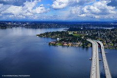 Bellevue Above & Beyond (TIA International Photography) Tags: seattle county city bridge blue sky terrain mountain lake mountains green home skyline clouds tia real island washington spring highway memorial king day cityscape estate view motorway suburban earth suburbia floating aerial mercer freeway vista daytime suburb interstate lacey residence range cascade 90 tone bellevue tosin vie topography murrow arasi tiascapes tiainternationalphotography