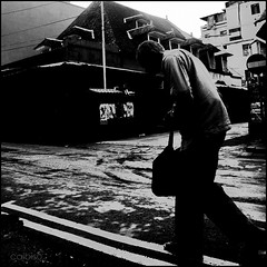 Over his shoulders (calbisu) Tags: street bw white black port louis raw mauritius 123bw bwartawart
