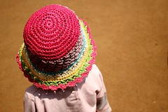 A Nice Sunny Day (Chitra Aiyer) Tags: pink people colors girl hat daughter kitlens dslr chitra nilgiris femalephotographer canon400d canondigitalrebelxti chitraaiyer ladyphotographer chitraaiyerphotography femaleindianphotographer