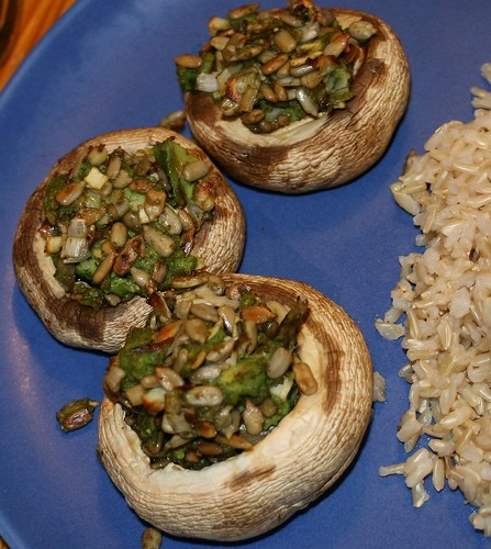 Mushrooms with avocado and sunflower seeds