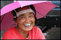 Well prepared for the rainy season (Helmut Schadt) Tags: umbrella philippines smiles baguio iloveyoursmile marketwoman