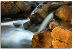 The Sunset Waterfall (Wolfman86) Tags: sunset nature water creek d50 river waterfall corn nikon rocks stream long exposure falls cascade soe napg mywinners anawesomeshot aplusphoto superbmasterpiece diamondclassphotographer betterthangood wolfman86