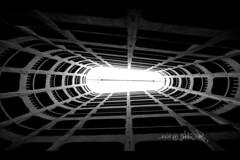 Spaceship tunnel??? (Julien Ratel ( Jll Jnsson )) Tags: light bw canon starwars bravo perfect photographer view lumire garage parking wideangle tokina1224 tunnel nb harmony imagination rotation spaceship cinematic eos350d soe the themoulinrouge fpc sobeautiful grandangle helical 50faves flickrsbest 25faves vaisseauspatial platinumphoto anawesomeshot hlicodal goldenphotographer favemegroup3 blackribbonbeauty betterthangood theperfectphotographer thegardenofzen thegoldendreams blueju38 julienratel sfmovie